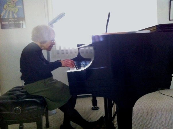 My adorable grandmother playing the piano! The game was guess the composer. I guessed Bach correctly!